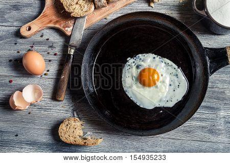 Closeup Of Fried Egg On A Cast Iron Pan