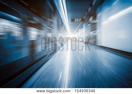 Blurred view of train leaving platform in city of China.