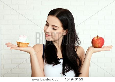 Woman with apple close-up face. Beautiful women exists to clean skin on the face that chooses to eat an apple or Cake. Asian woman.