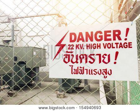 Warning Danger High Voltage Sign And Thai Language Mean Danger High Voltage Also. A Big Red. 22 Kv.