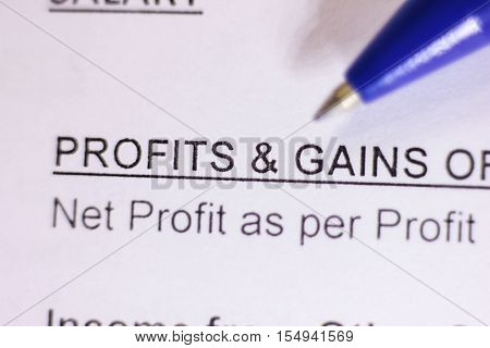 Close-up of profit and gain word on paper