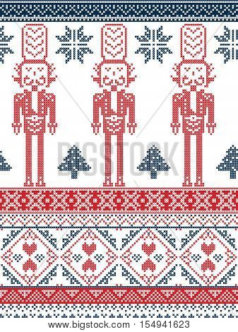 Scandinavian Printed Textile  style and inspired by Norwegian Christmas and festive winter seamless pattern in cross stitch with Xmas trees, snowflakes, Nutcracker Soldier hearts in red and blue