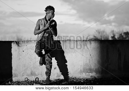 Black Afroamerican Man Gangsta Rap Singer. Black And White Photo