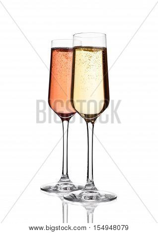 Glasses of pink and yellow champagne on pink with bubbles on whitebackground