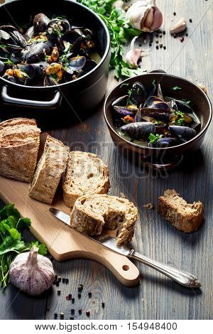 Mussels Served With Bread With Garlic And Parsley