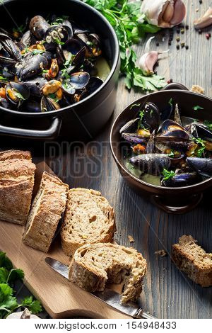 Closeup Of Mussels Served With Bread With Garlic And Parsley