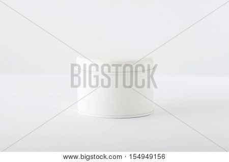 Closed White Cylindrical Box on White Background
