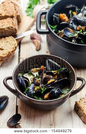 Freshly cooked mussels at home on old wooden table