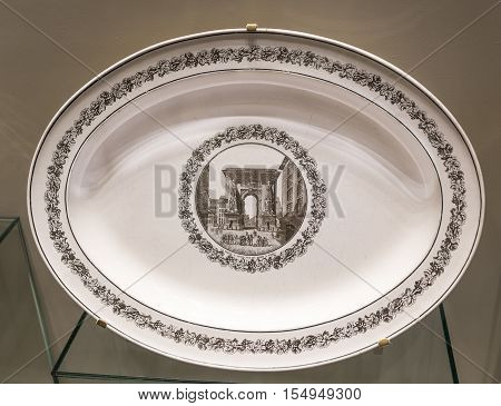 Moscow Russia -September 082016: Table set with views of Paris. Plate with the image of the Porte Saint-Denis in the north. Museum of the Patriotic War of 1812