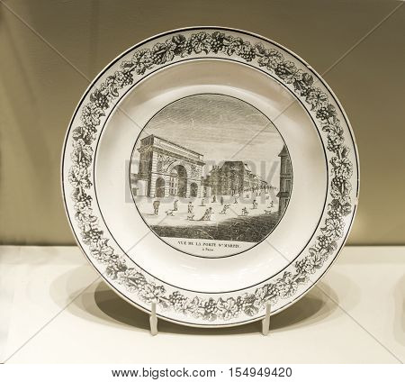 Moscow Russia -September 082016: Table set with views of Paris. Plate with views of the Saint-Martin Gate. Museum of the Patriotic War of 1812