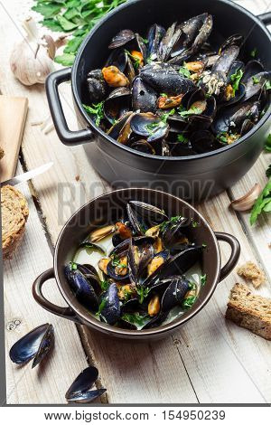 Closeup Of Cooked Mussels With Garlic And Parsley