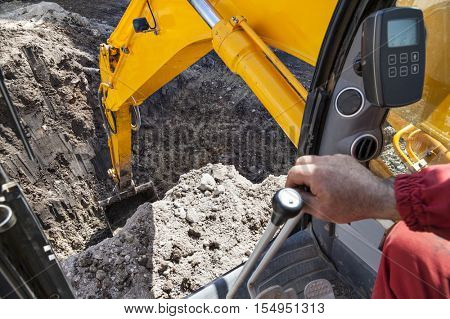 excavator digging hole ground