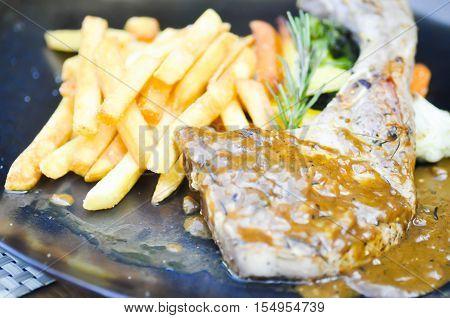 pork chop or pork steak with French Fries dish
