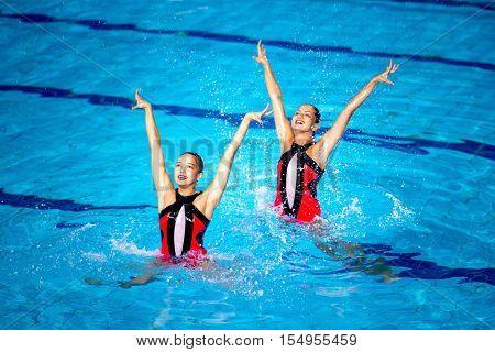 Synchronized swimming competition, toned image, horizontal image