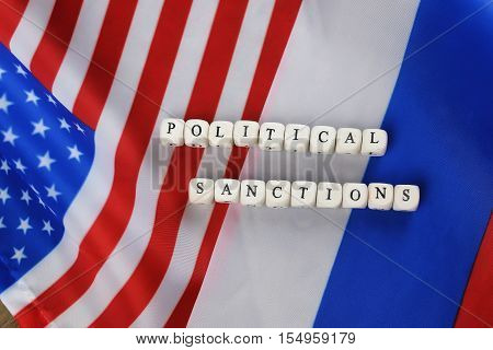 russian usa flag sanctions wooden letters on them