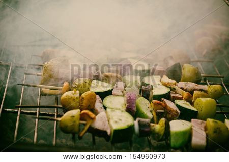 Skewers With Slices Of Potatoes, Zucchini, Bacon, Mushrooms, Onion, Kohlrabi Grilled Over The Charco