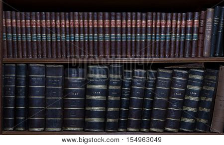 Old book in a wooden row library