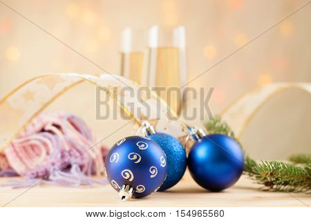 Christmas balls, fir tree branch, ribbon, scarf and champagne
