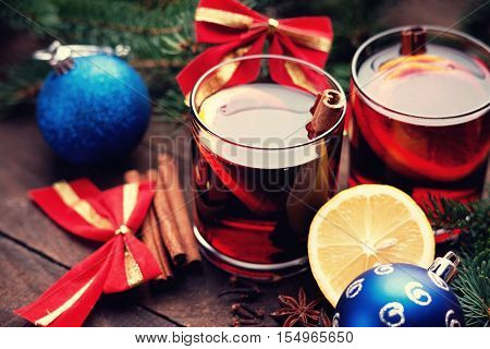 Hot mulled wine with spices, lemon and christmas balls