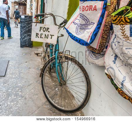 ZANZIBAR, TANZANIYA- JULY 16: bicycle for rent on a street of Stone townon July 16, 2016 in Zanzibar