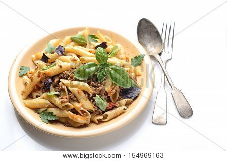 asta with meat and basil on a plate on a white background