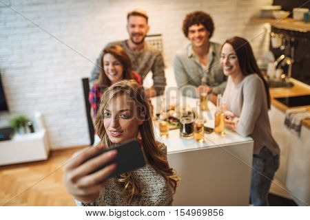 Friends making selfie while eating at home.