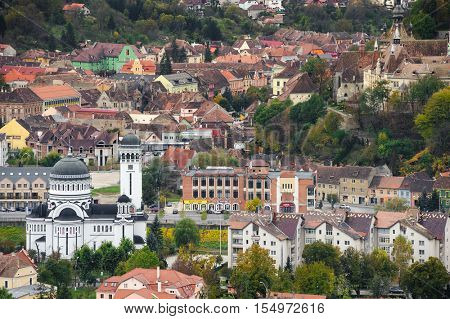 Sighisoara, Romania - October 19th, 2016: Panoramic view over the cityscape and architecture in Sighisoara