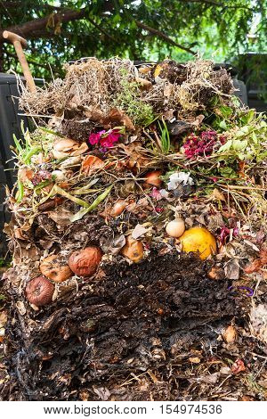 Compost pile opened up showing the layers of compost