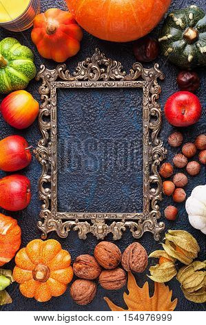 Set of autumn harvest around a carved frame top view with copyspace