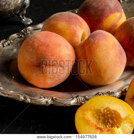 Ripe Peaches On A Silver Platter