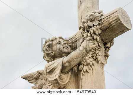 Angel And Cross Sculpted Statue
