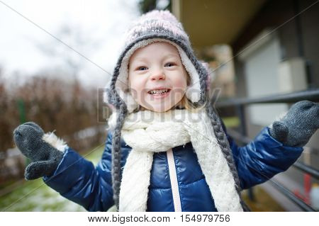 Adorable Little Girl Making Funny Faces Outdoors