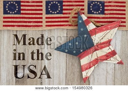 Made in the USA message USA patriotic old Betsy Ross flag old star and weathered wood background with text Made in the USA