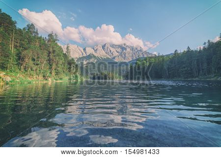 Fantastic day on mountain lake Eibsee, located in the Bavaria, Germany. Dramatic unusual scene. Alps, Europe. Toned