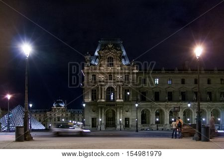 PARIS, FRANCE - april 22, 2016: The Louvre palace in the Carrousel Square at night. Louvre Museum is one of the largest and most visited museums worldwide