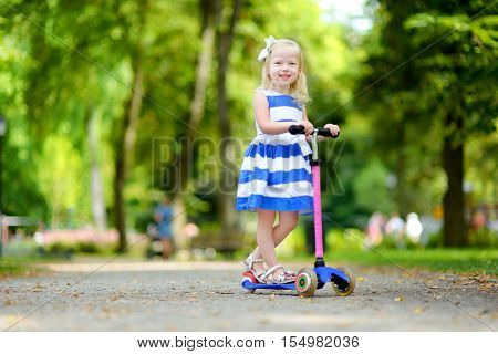 Little Girl Riding Her Scooters