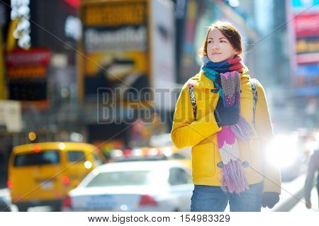 Beautiful Young Woman Sightseeing At Times Square