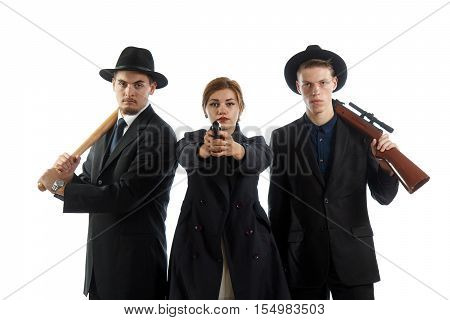 A group of elegant young people with weapons