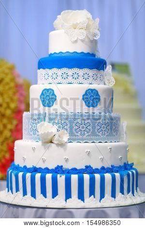 Big Wedding Cake Decorated With Flowers