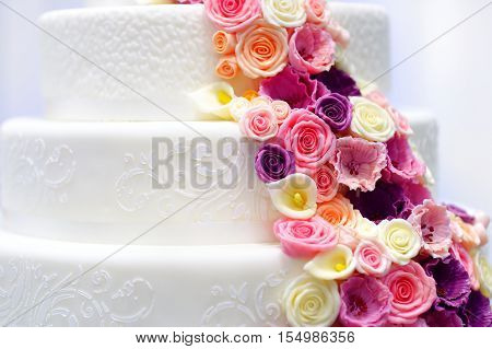 Detail Of A Wedding Cake Decorated With Sugar Flowers