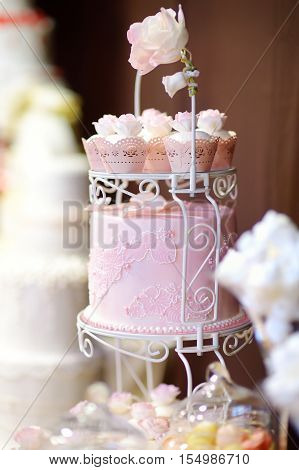White Wedding Cupcake Cake Decorated With Flowers