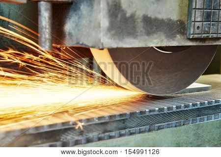 metalworking machining industry. finishing or grinding metal surface on horizontal grinder machine at factory