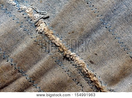 Old Dirty Worn Jeans With Rough Stitch.