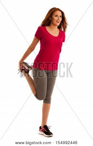 Stretching - Woman Stretches Leg Muscles After Fitness Workout In Gym Isolated Over White Background