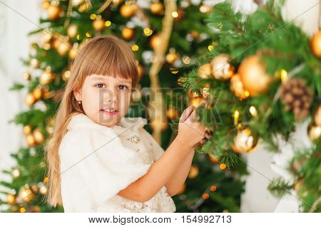 girl  smiling  christmas ornaments  gold  new yea