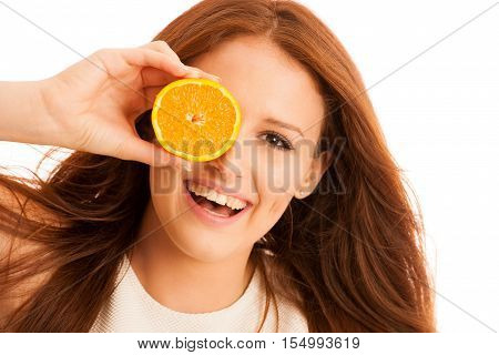 c-vitamine woman - girl with orange fruit in front of her face