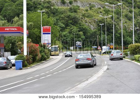 Igalo, Montenegro - June 15, 2016: Detail of Hip Hop Petrol gas station and part of road with vehicles. Hip Hop Petrol gas station is located in Igalo town, Montenegro.