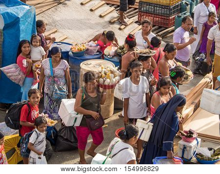 Amazon River Peru: - May 12 2016: Local people with goods to be sold on board of a cargo boat.