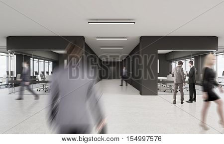 People Walking In Office With Black And Glass Walls