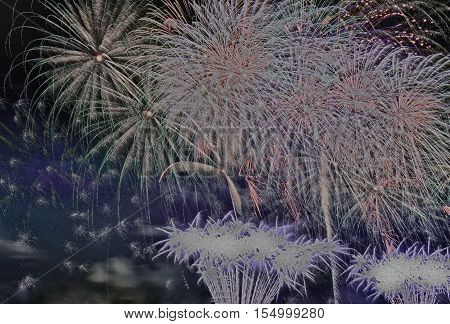 Great fireworks display at night on the occasion of the New Year. with special filter effect partialy black and white.Closehorizontal view.